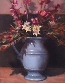 Oil painting of flowers (including jonquils, bottle brush flowers and possibly anemones) in a large blue ceramic jug.