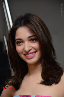 Actress Tamanna Latest Images in Floral Short Dress at Okkadochadu Movie Promotions  0027.JPG