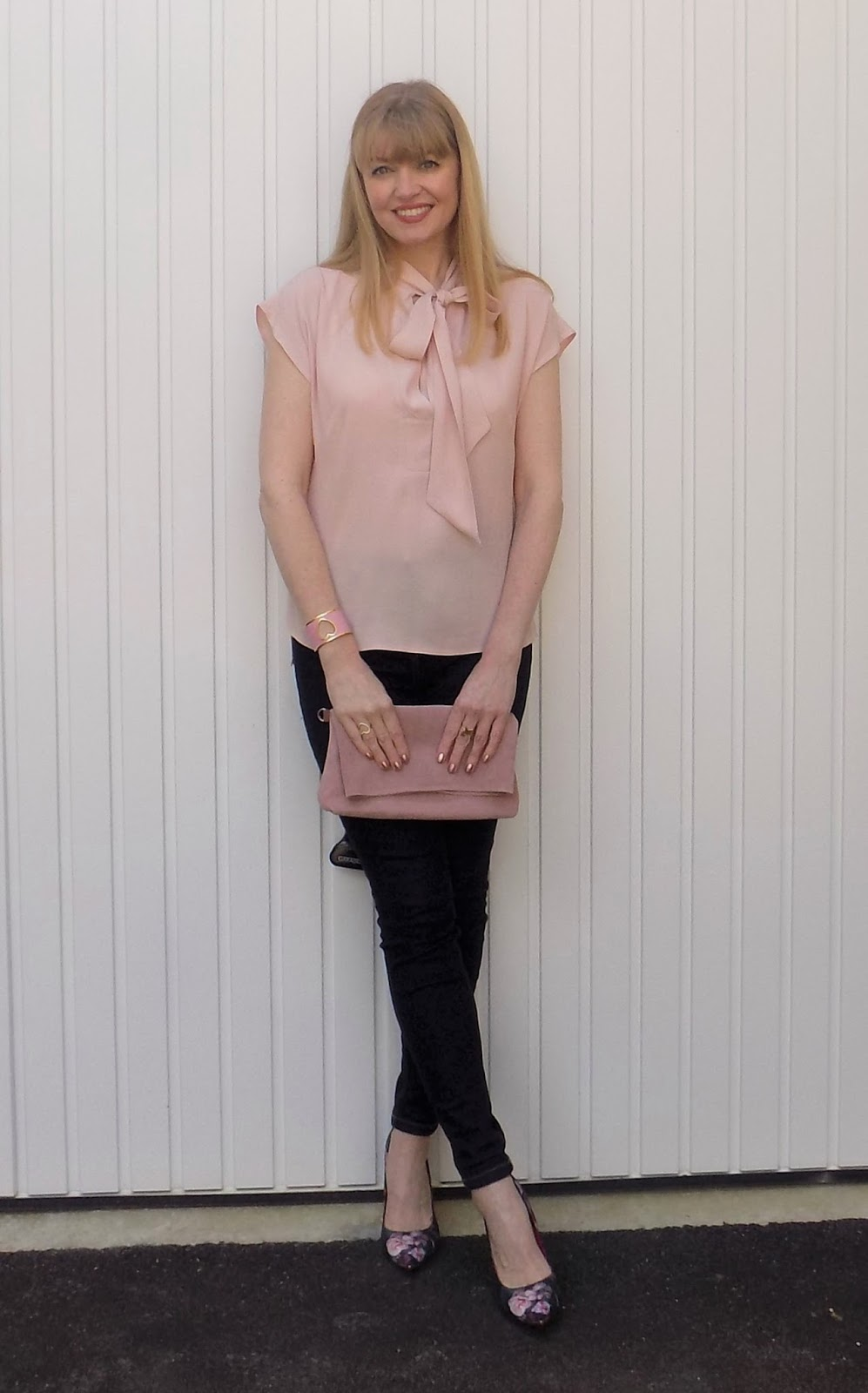 Pink pussy bow blouse with skinny jeans and floral shoes