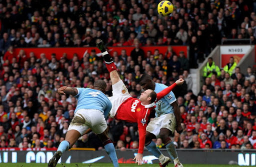 Manchester United forward Wayne Rooney of scores from an overhead kick against Manchester City