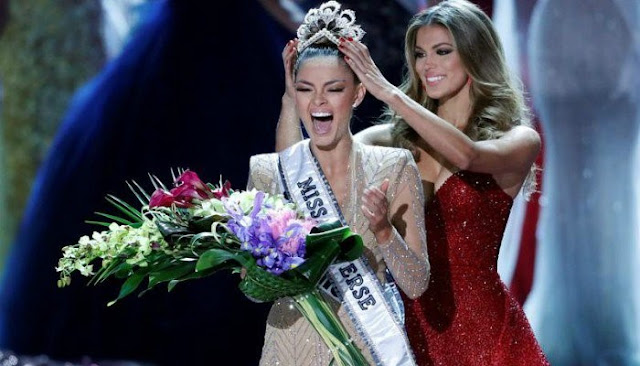 Miss South Africa Demi-Leigh Nel-Peters reacts as she is crowned by Miss Universe 2016 Iris Mittenaere during the 66th Miss Universe pageant at Planet Hollywood hotel-casino in Las Vegas, Nevada, U.S. November 26, 2017. REUTERS