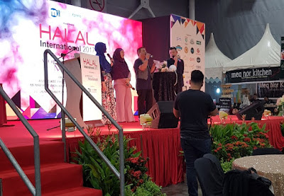Exhibitors speak on stage about their wares.