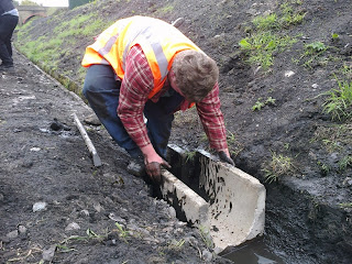 Ryan setting out drainage channels near the signalbox