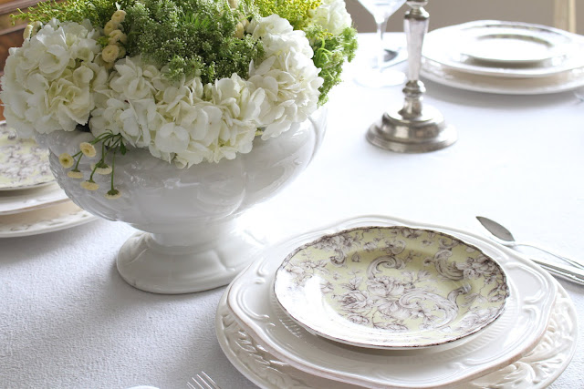 spring floral tablescape green white flowers ironstone green toile plates