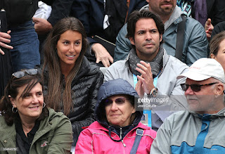 Fernando with his girlfriend cheering on in a French Open game