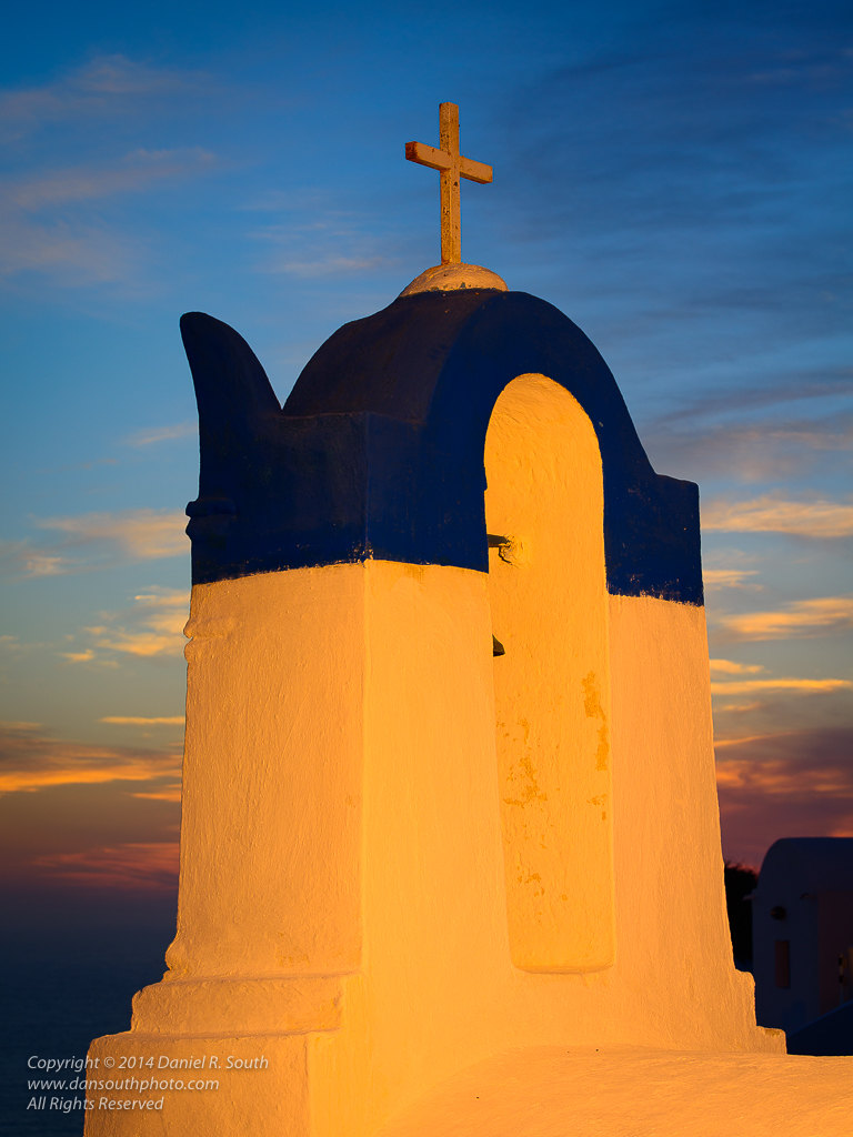 a photo of a santorini chapel at sunset enhanced by fill flash