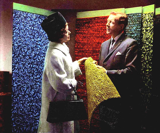 1967 carpet store interior color photograph with models