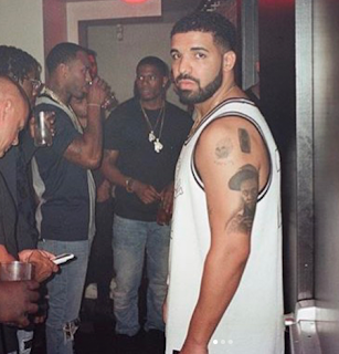 Drake Gets Lil wayne's Head Tattooed on his Arm
