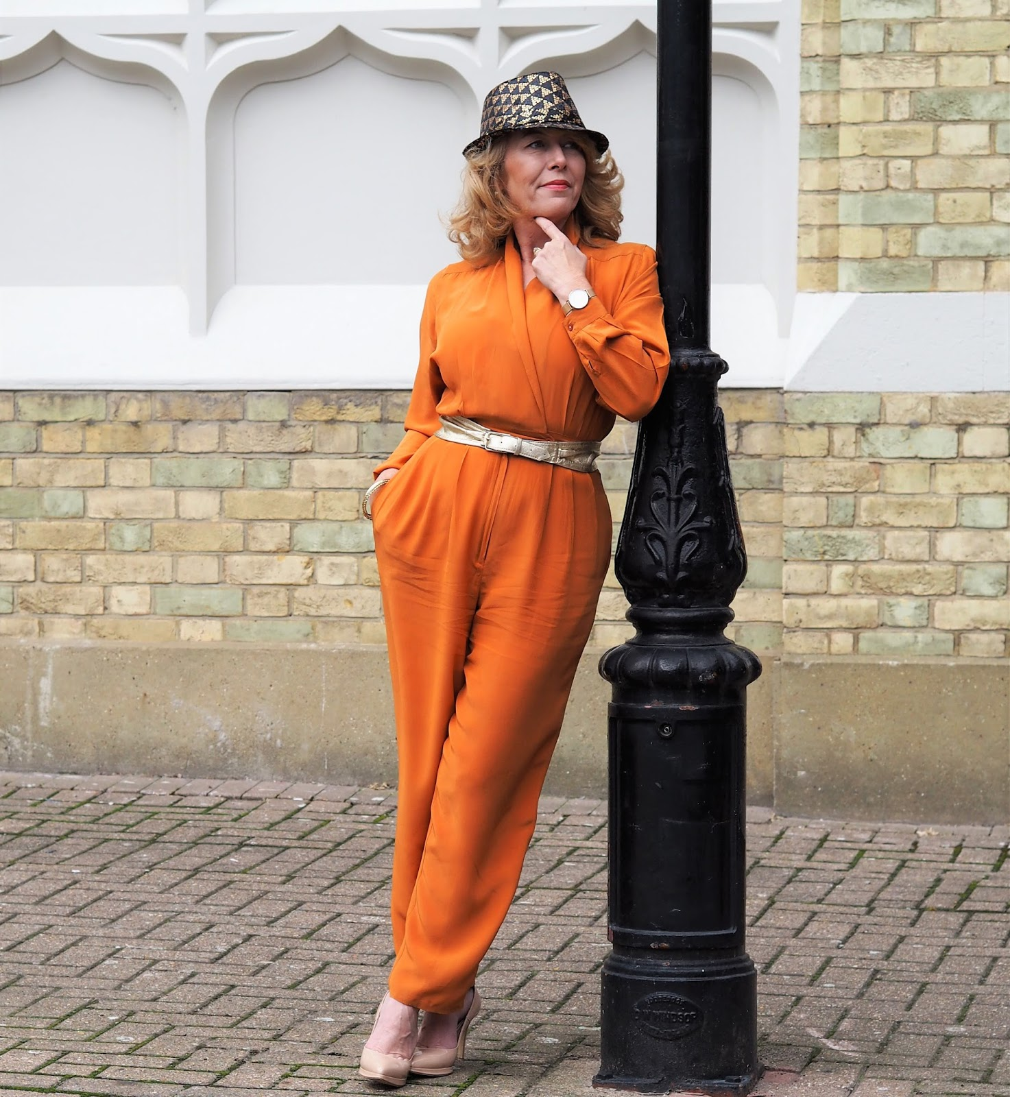 A vintage jumpsuit is the perfect accompaniment to a jaunty hat for Laurie Bronze over 40s blogger