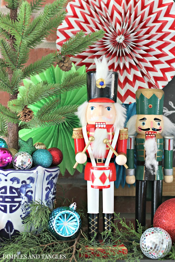 drummer nutcracker, paper fans, christmas decorations, christmas mantel
