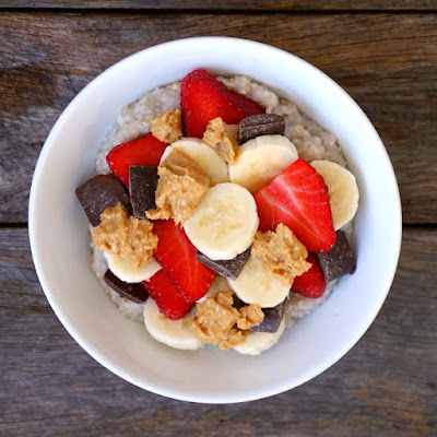 Oatmeal Bowl with Chocolate Chips, Banana, Strawberries and Peanut Butter