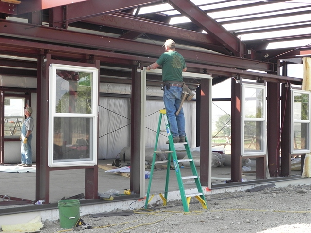 A Carpenter For Christ Putting Up The Steel Building At