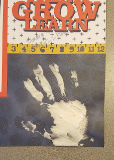 close-up of child's handprint made with Texture Paste on a scrapbook page