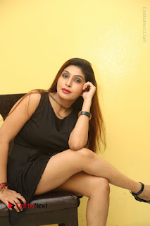 Tollywood Upcoming Actress Pooja Roshan Stills in Black Short Dress at Plus 1 Movie Trailer Launch  0272.JPG
