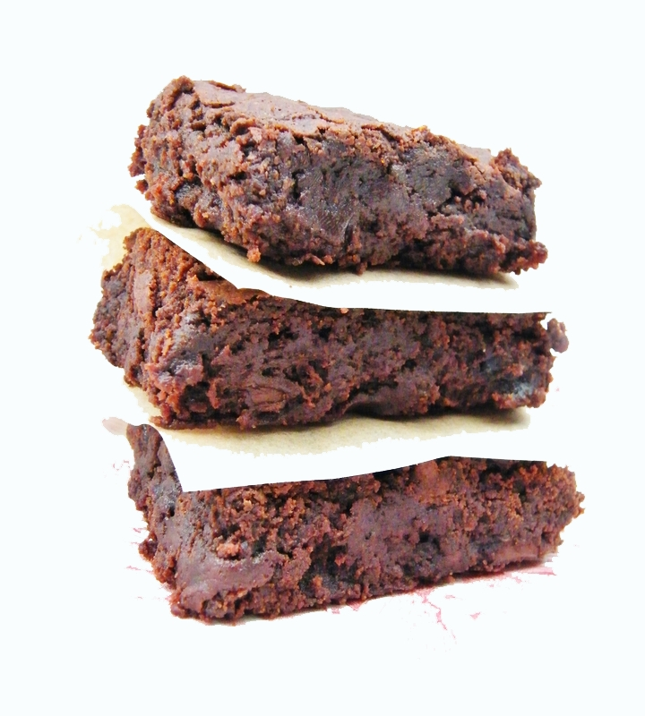 Fudgey chocolate brownies that are egg and dairy free. Made with bitter dark chocolate, prunes for sweetness and flaxseeds for a healthy boost.