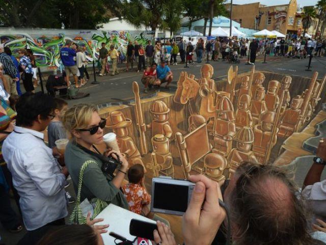 Artistas de rua fazem desenhos 3D com personagens do Lego