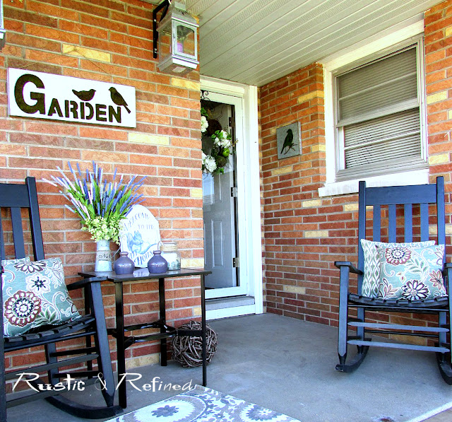 Spring decorating on a small patio using black rockers and antique crab pots