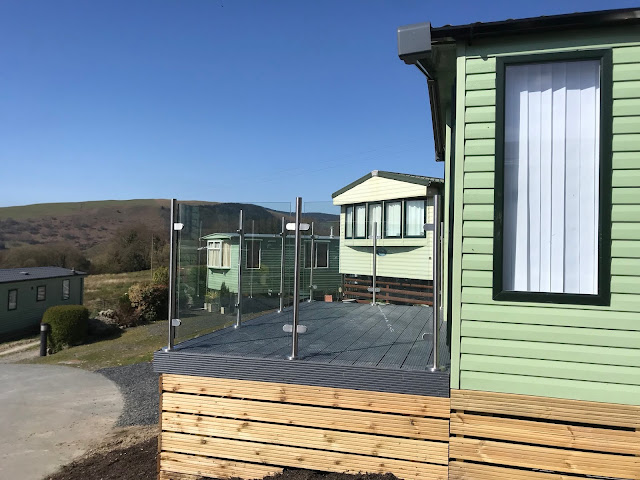 glass panel and steel post decking