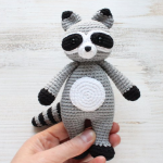 https://amigurumi.today/crochet-cuddle-me-raccoon-amigurumi-pattern/