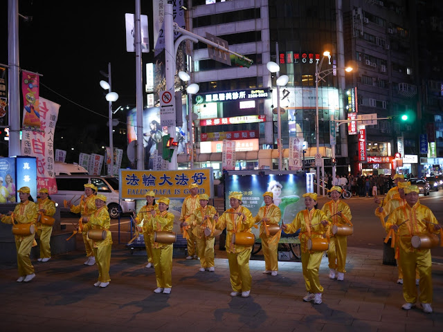 Falun Gong adherents playing drums at Ximending in Taipei