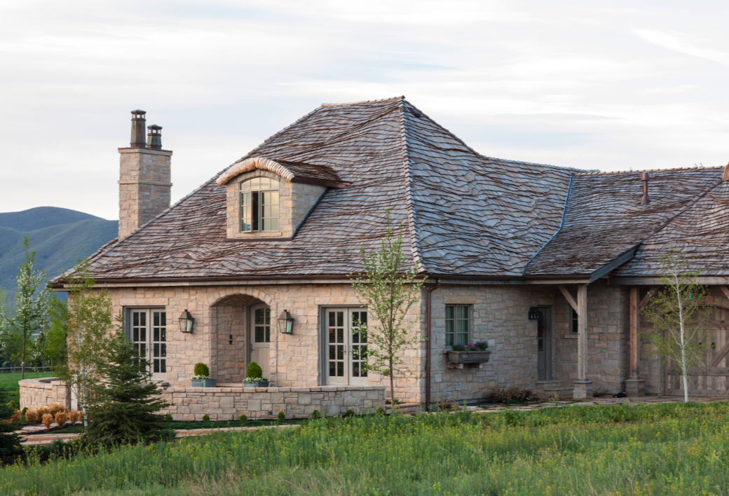Beautiful stone facade and French Gustavian architecture at a French cottage in Utah. Come see this Rustic Elegant French Gustavian Cottage by Decor de Provence in Utah! #frenchcountry #frenchfarmhouse #interiordesigninspiration #rusticdecor #europeanfarmhouse #housetour