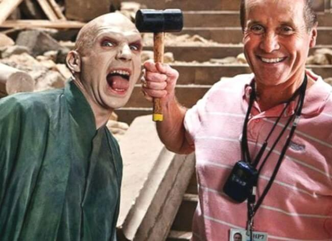 60 Iconic Behind-The-Scenes Pictures Of Actors That Underline The Difference Between Movies And Reality - Voldemort gets hammered on the set.