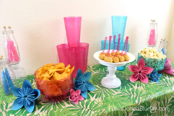 Here is a quick tutorial on how to fold kusudama origami flowers and host a tropical party this summer! If you can't go on a tropical vacation, bring the tropics home to you! Click through for more details. #BringTheTropicsHome #ad