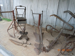 antique steel farm tiller