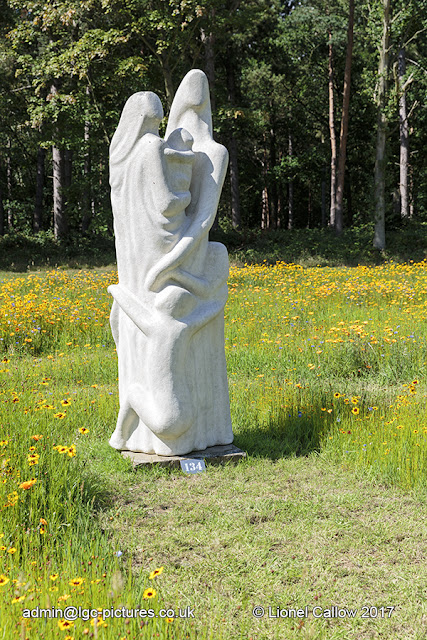 Set in the middle of a wild flower maze this sculpture is made from stone resin