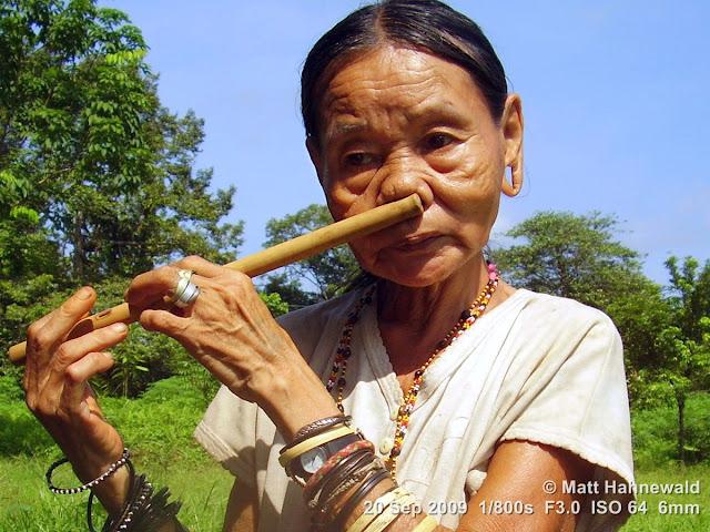 Penan woman, street portrait, nose flute, mongurali, elongated earlobes, stretched earlobes, holes in earlobes, Borneo, Sarawak, Gunung Mulu National Park, Batu Bungan