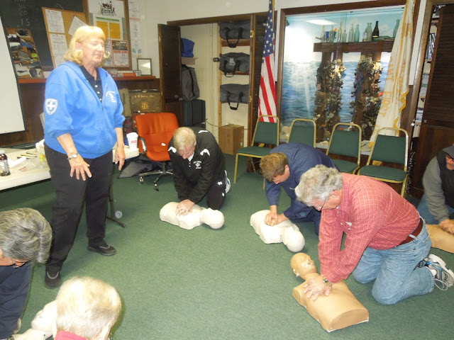 R.Sheridan, S.Gallagher, P.Harren practice CPR technique under direction of F.Melo