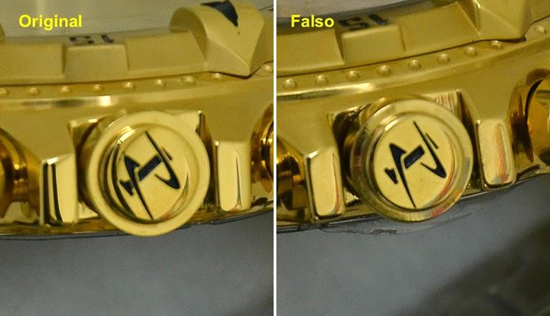 34132f3cbfd Quarto  O pino da pulseira desta réplica é prateado e comum. O original é  dourado e bem acabado.
