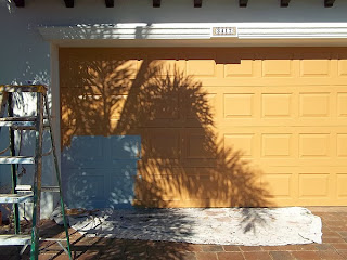 Garage door painted to look like wood.