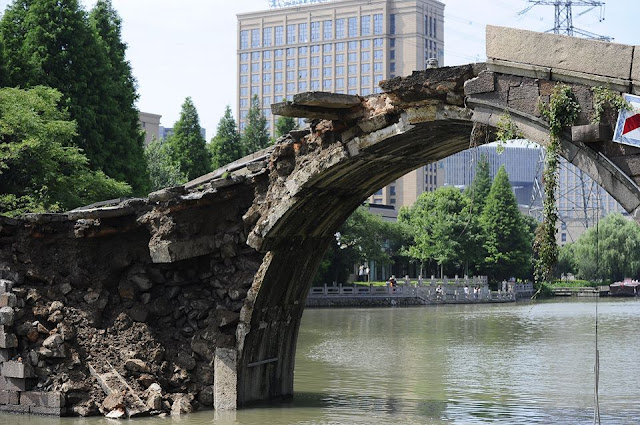 Centuries-old bridge in Hangzhou collapses following days of downpour