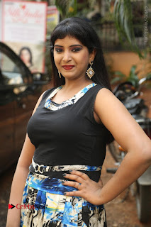 Actress Model Poorni Stills in Floral Long Dress at Silk India Expo Launch  0022.JPG
