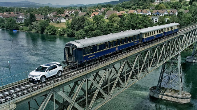An ad for  Land Rover Discovery Sport showing it towing a train over a long bridge has gone viral.  The slick visual shows a white-coloured Land Rover pulling three coaches of the train over a 85-feet bridge in Switzerland.  We are informed that the Land Rover, which comes with 178-bhp diesel engine, is built to tow about 2.5 tonnes of the weight. So, it is indeed impressive when it pulls along a train weighing 100 tonnes, 58 times over its designed capability.