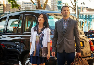 Jonny Lee Miller and Lucy Liu as Sherlock Holmes and Joan Watson in London in CBS Elementary Season 2 Poster
