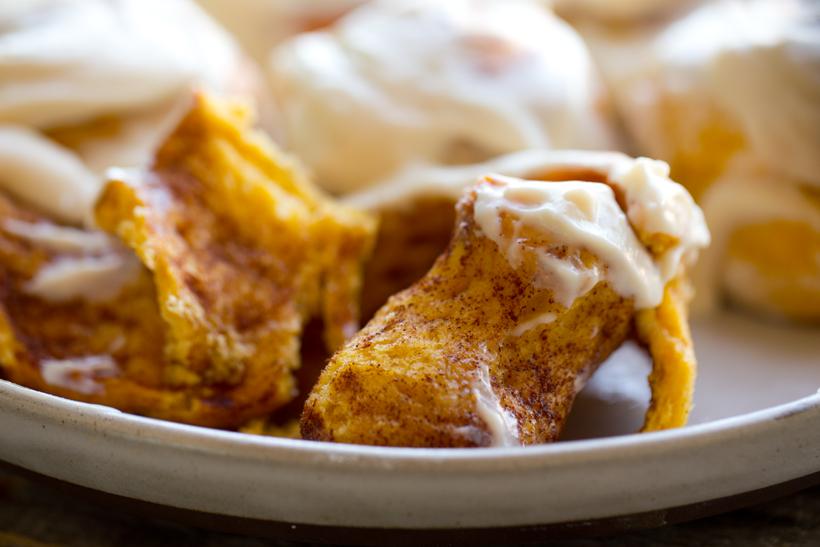 vegan pumpkin cinnamon rolls inside dough