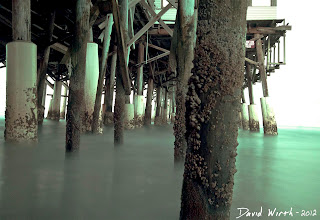 under the pier at cocoa beach, ocean florida, waves, water