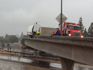 Bakersfield semi truck crash highway 99 58 interchange overpass rain may 2015