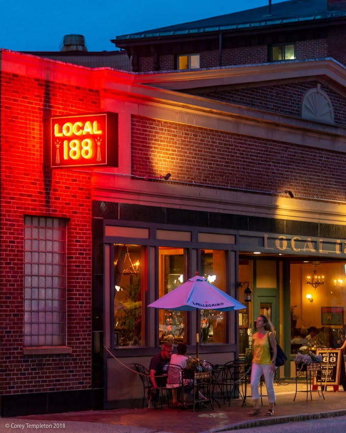 Portland, Maine USA August 2018 photo by Corey Templeton. Sidewalk dining under the neon light of Local 188.