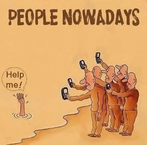 25 Pictures That Prove Technology Is Ruining Society - Why save someone when you can take a video of them?!