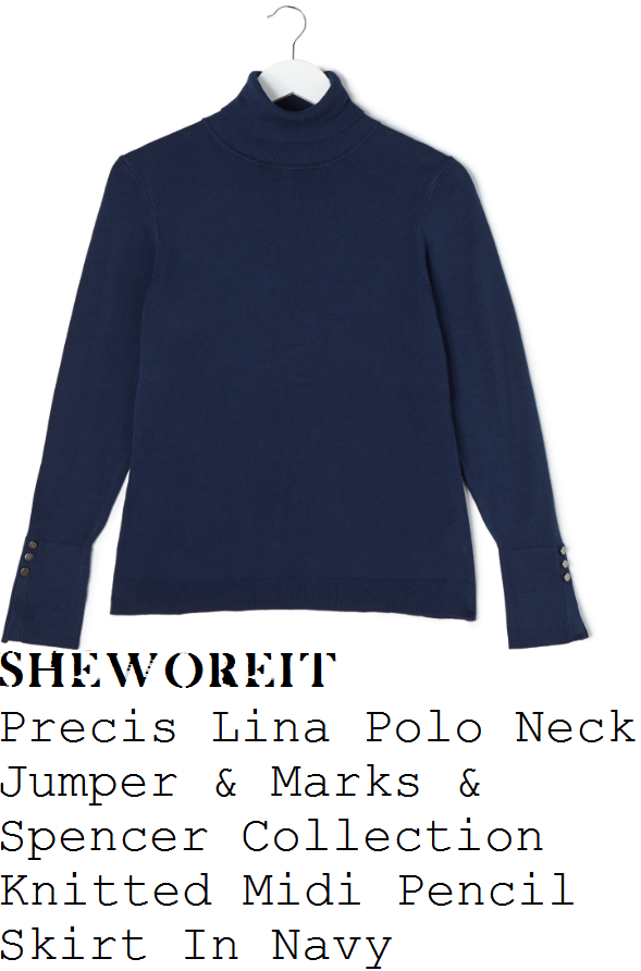 holly-willoughby-precis-lina-navy-blue-long-sleeve-high-polo-neck-button-split-cuff-detail-fine-knit-jumper-and-marks-and-spencer-collection-navy-blue-high-waisted-pencil-midi-skirt