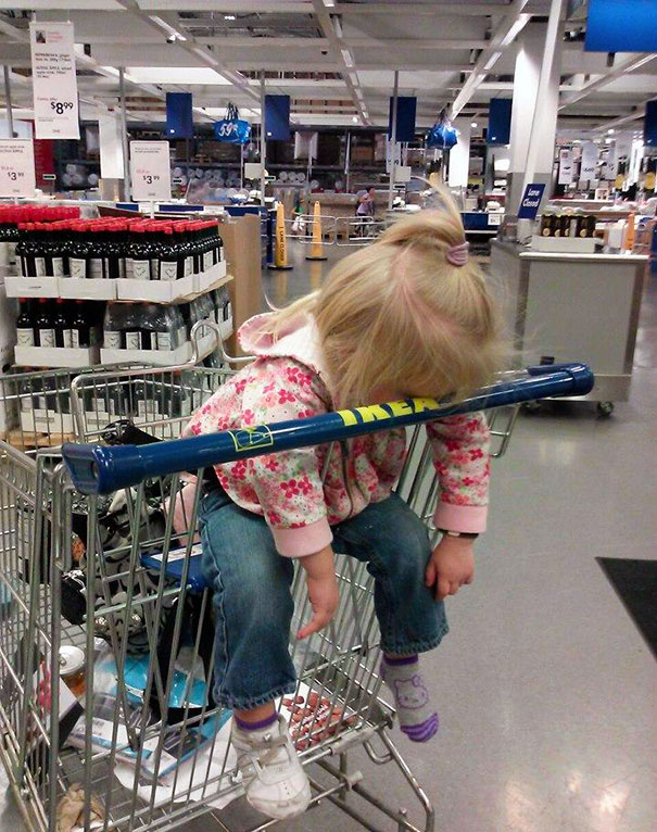 15+ Hilarious Pics That Prove Kids Can Sleep Anywhere - Napping At Ikea