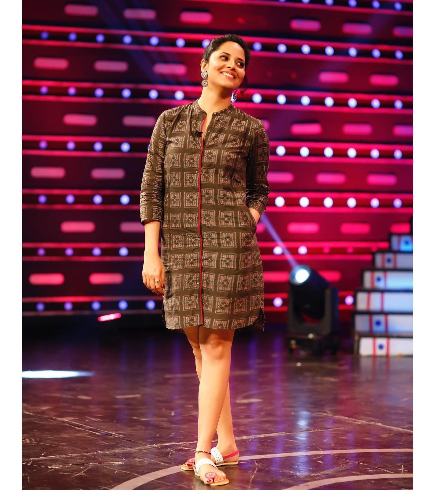 Indian TV Actress Anasuya Long Cross Legs In Black Skirt