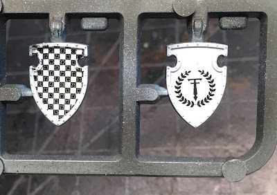 Painting heraldry for Legio Tempestus on the Warlord's shields.