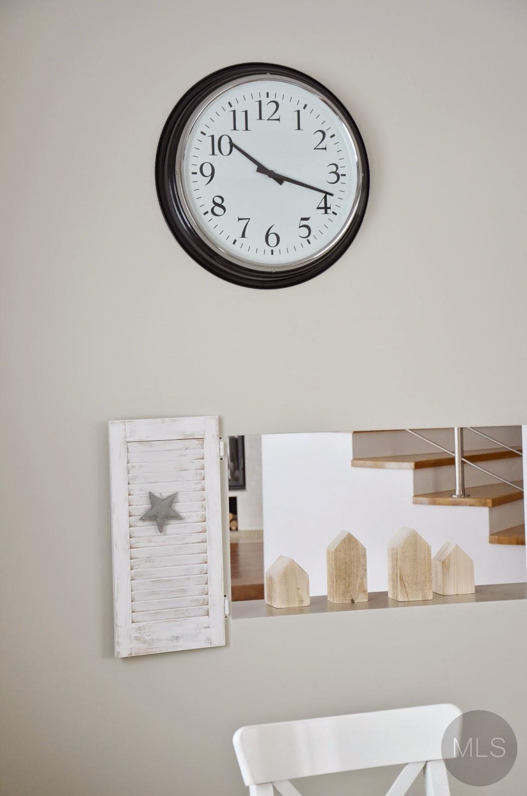 Oversized clock & wooden houses