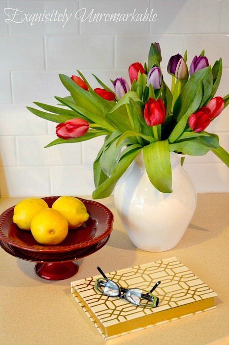 Tulips and accessories on a desk for charm