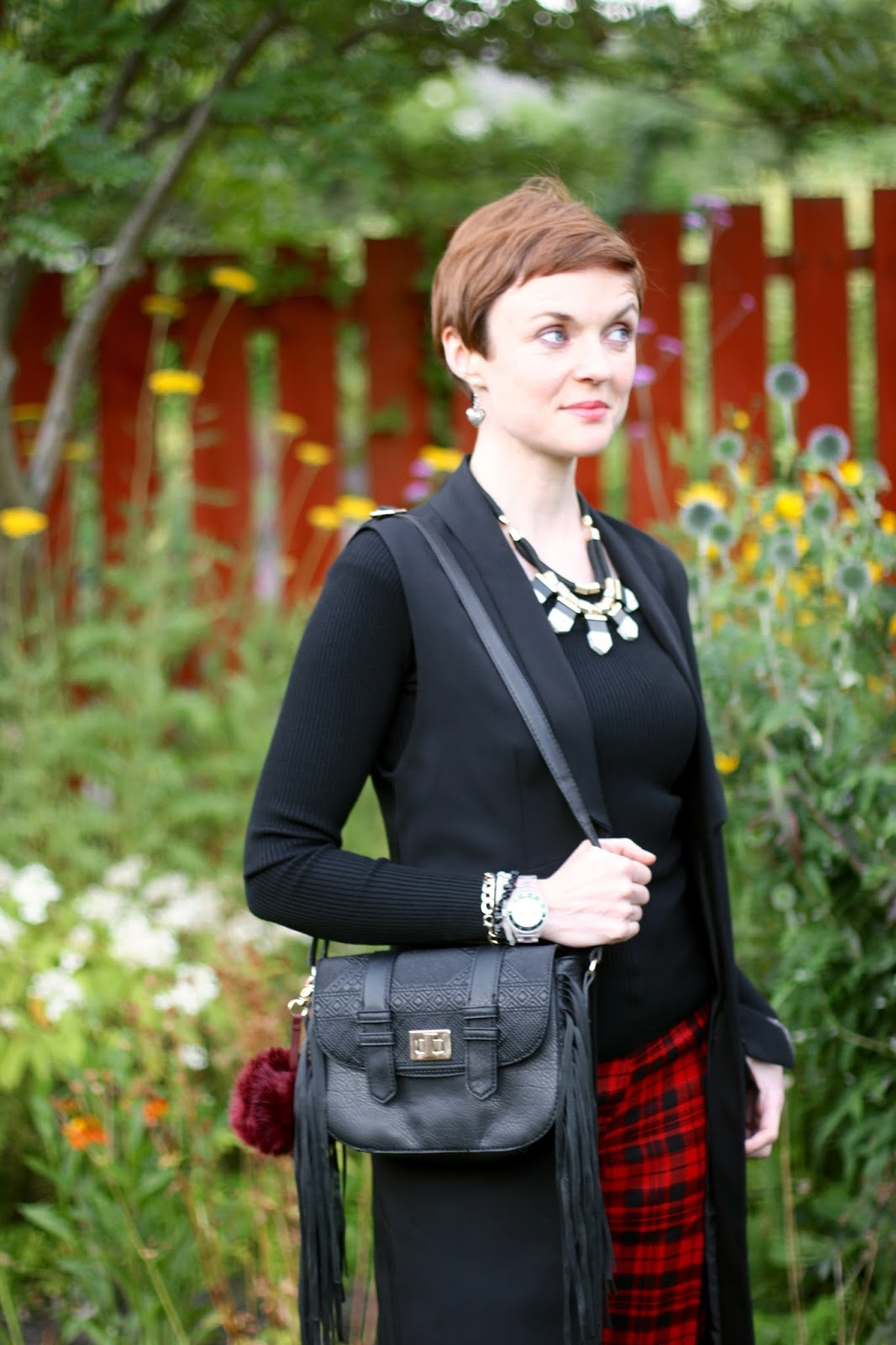 Black and Red tartan , tassel bag with a statement necklace.