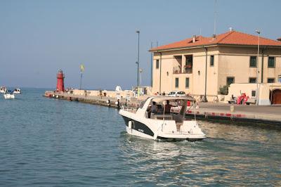 Castiglione della Pescaia boats heading out to sea